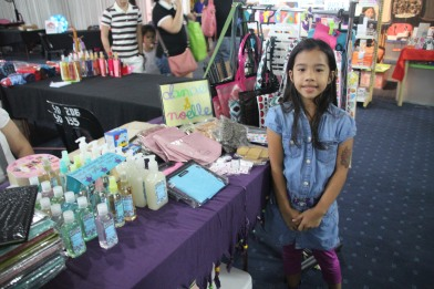 Danae in front of our booth. One of the very few times that she was haha. :)