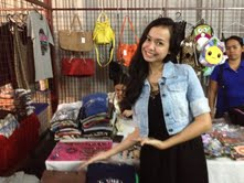 Matthew's booth, with sister Micah modelling! His mom sold shirts and accessories. :)