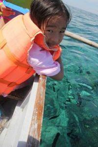 Noelle feeding the fish.