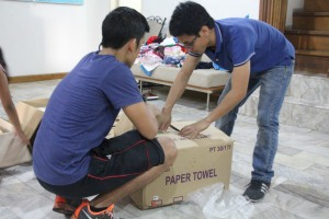 Two of our men, fixing our boxes of packed meals. This was after they loaded the sacks of goods onto the jeepney.