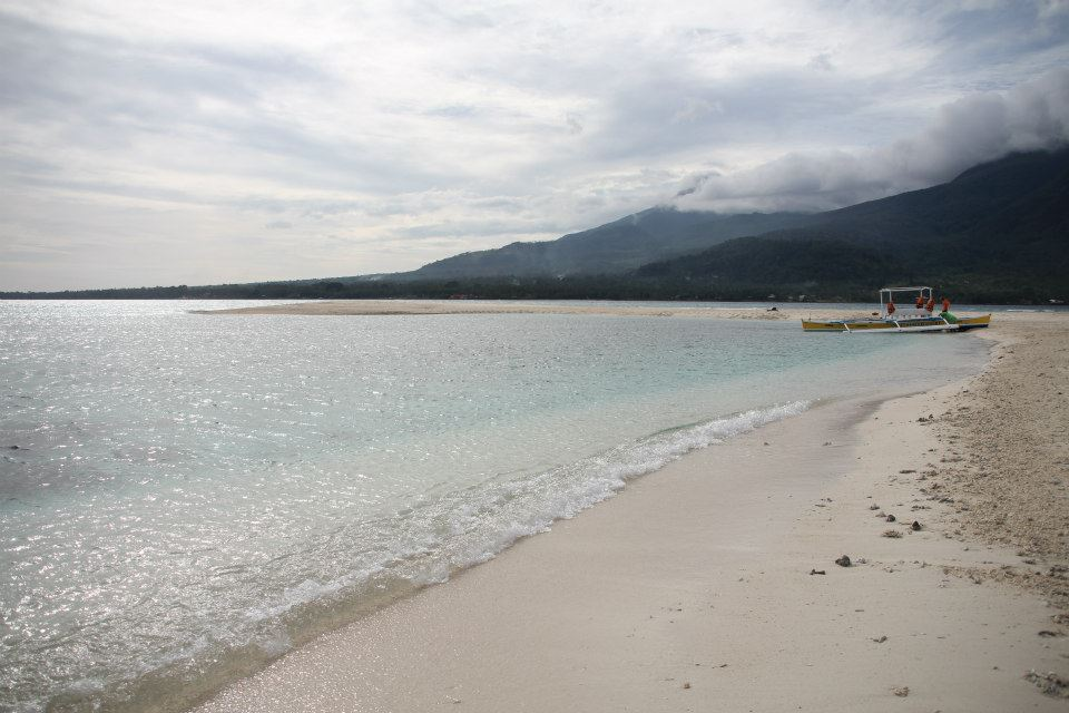 Beautiful blue water on White Island, a sandbar ten minutes away from Paras Beach Resort via small boat.