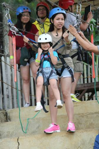 "Noelle's first time to do the zipline EVER! This is a huge deal because she almost cried the previous day when she was about to do it with me. This time, for some reasons she agreed to ride with her ""sister"" Nina. She conquered her fear! We were so proud of and happy for her!"