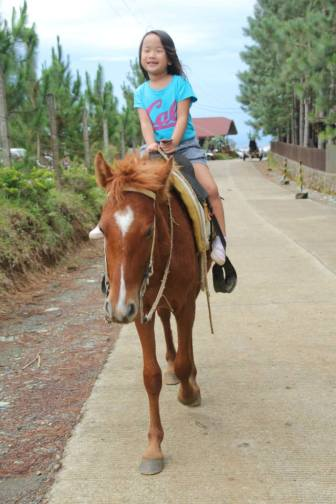 Noelle's first time to ride solo on a horse too!