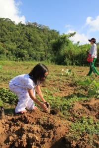 Noelle planting a seedling :)