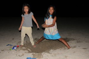 Playtime in the sand before going to bed. Had a couple of funny boo-boos -- one of em picked up something gross while thinking it was a coral or rock; the other picked up something that she thought was a rock but she literally freaked out & cried when it moved. Haha. :)