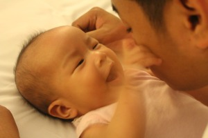 talking to daddy and touching his face :)
