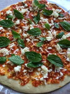 We used store-bought pizza dough (one day I'll make my own), spread the pizza sauce which was on the stove for around 2 hours until it became saucy, put mozzarella cheese and more basil. You can add whatever ingredient you want. My kids like cheese and they're okay with basil. so we kept it simple. :)