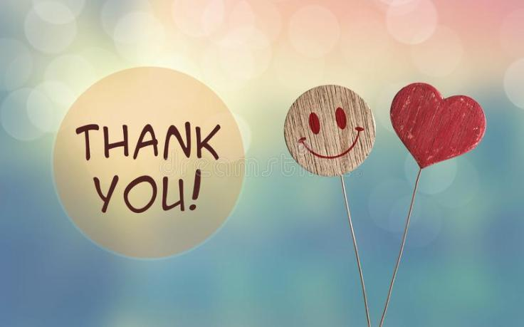 thank-you-heart-smile-emoji-wooden-bokeh-light-background-125814550